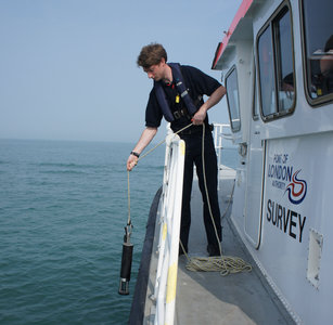 Surveyor Alex Mortley lowers the calibration equipment ready for the survey