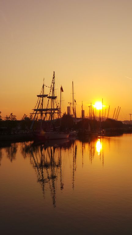 Some of Tall Ships Regatta fleet: sunrise at West India Dock